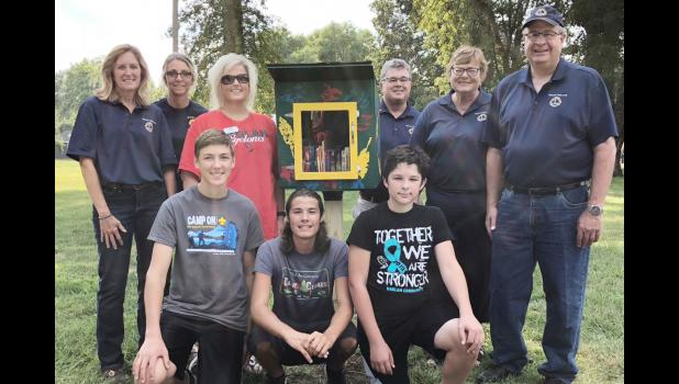 Pictured are Harlan Lions Club and Library representatives along with kids front L to R -- Reece Nielsen, Niall Mahoney and Quinn Mahoney. Back L to R -- Christine Petersen, LaDonna Havick, Amanda Brewer, Chuck Hoffnagle, Ilene Nelson and Verne Nelson.