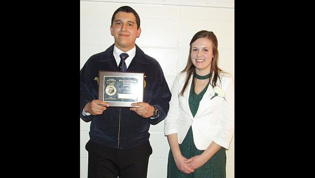 Miguel Mena named DeKalb award winnner, pictured with HCHS FFA Advisor Justine McCall.