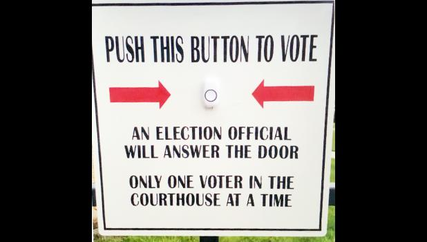 If voting at the courthouse before election day, push this button near the door and someone will come get you.