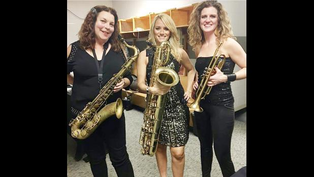 Horn section includes Jenny Hill (tenor sax), Lauren Sevian (baritone sax), and Alicia Rau (trumpet)