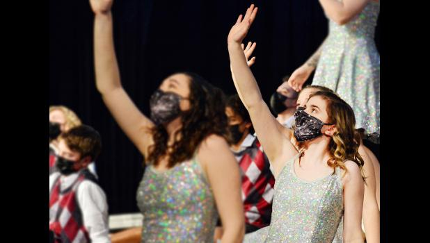 Ava Miller (top, far right) performs with Breaking Cylence during dress rehearsal last week.