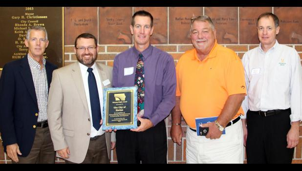 Pictured with the award are L to R -- Mike Kolbe, SWIPCO Policy Council Chairperson and Harlan City Councilperson; John McCurdy, executive director, SWIPCO; Harlan Mayor Gene Gettys, Jr.; Harlan City Administrator Terry Cox; and Terry Arentson, SWIPCO Policy Councilmember.