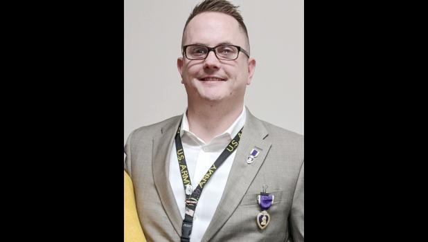 Former Harlan resident Jonathan Tilk has been awarded the Purple Heart.  (Photo contributed)