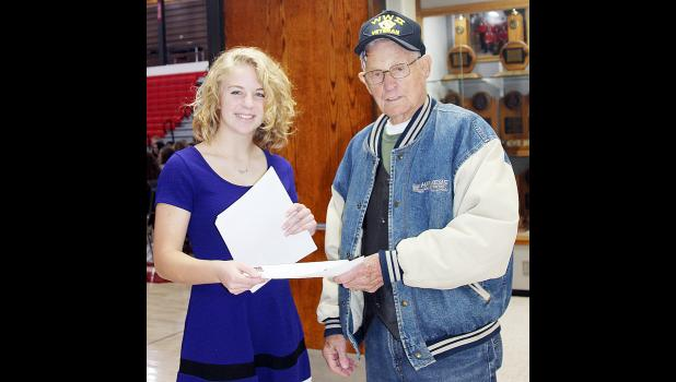 Anna Nelson greets World War II veteran Rex Davis as he arrives at the veterans program at HCHS. Davis served in the United States Marine Corps.