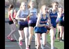 AHSTW's Holly Hoepner starts her leg of the Lady Vikes' first-place 4x400 relay after taking the baton from Cora Comer (right).