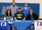 AHSTW senior AJ Sieh is seated next to his parents, Alan and Bobbi Sieh of Avoca. Back row, left-right: NWMSU assistant coach and recruiting coordinator Joel Osborn (a 2004 graduate of Harlan Community) and AHSTW head football coach Davis Pattee. AJ's father, Alan, and his sister, Ashley, are both graduates of NWMSU.