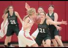IKM-Manning senior Aly Stadtlander (21) pressures Treynor guard Kayla Chapman at the top of the key during Friday's first half.