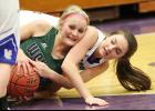 IKM-Manning sophomore Alexa Ahrenholtz fights for a loose ball with Woodbury Central's Sidney Steffen. (Photos by Mike Oeffner)