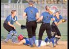 AHSTW's Katie Anzalone is able to dive safely into third base amidst a quartet of Underwood players to avoid being tagged in a rundown for the final out of Monday's game.