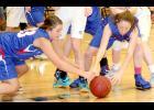 AHSTW's Morgan Eckmann (left) and Katie Anzalone scramble for a loose ball. (Photos by Kim Wegener)