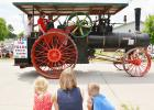 The parade was definitely a highlight, with this old steam engine as one of the entries.  Here, three parade-goers watch as the entries go by.   (Photo by Ryan Pattee)