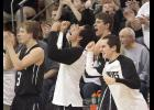 Left-right: IKM-Manning players Jon Brandt, Noah Harlow, Austin Dahlgren and Trevor Cast celebrate a big play during the Wolves' 65-60 substate final win over Nodaway Valley on February 27. (Photo by Mike Oeffner)