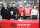 Front row: Eli Boldan is seated next to his stepfather, Cole Custer. Back row, left-right: HCHS head football coach Curt Bladt and assistant coaches Mark Kohorst, Sam Brummer, Todd Bladt and John Murtaugh. Not pictured: Michelle Custer (Eli's mom). (Photo by Mike Oeffner)