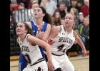 Exira-EHK's Kealey Nelson (left) and Kamryn Waymire box out a CAM player during Friday's regional semifinal.