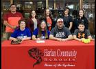 HCHS senior Emily Brouse signed a letter of intent Nov. 2 to play softball at Iowa Western CC. Front row: Emily is seated next to her parents, Ryan and Jamie Brouse, and younger brother Jacob. Back row: Jeff Martinez (travel ball coach), HCHS coach Brandi Eckles, HCHS head coach Toshia Kasperbauer, HCHS coach Ann Heithoff, former HCHS coach Brooke Wilson.