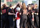 HCHS players celebrate Emily Brouse's fifth-inning home run during Monday's 10-0 win over Lewis Central. Madison Schumacher also homered for the Cyclones.