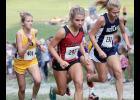 HCHS junior Chloe Hansen (center) begins a tough uphill climb during the early stages of Saturday's Abraham Lincoln Cross Country Invite. Hansen finished 45th out of 81 varsity runners.
