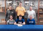Front row: HCHS senior Caleb Rasmussen is seated next to his parents, Randy and Carmen. Back row: HCHS boys basketball head coach Mitch Osborn, Briar Cliff men's basketball head coach Mark Svagera, HCHS boys basketball assistant coach Chad Swanson.