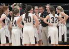 Exira-EHK coach Tom Petersen talks to his team during a timeout. (Photo by Mike Oeffner)