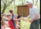 Iowa Department of Natural Resources Fisheries Biologist Bryan Hayes asks IKM-Manning sixth-grader Ty Jasa to put his finger into a fish's mouth.