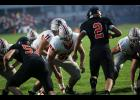 Harlan Community center Jeremiah Davis (55) and left guard Austin Schumacher (right) are part of an improving Cyclone offensive line entering Friday's Week 3 matchup against Sergeant Bluff-Luton.