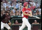 HCHS junior Ryan Doran watches his three-run double soar toward the right field fence during the second inning of Tuesday night's Class 3-A state quarterfinal game vs. Oskaloosa at Principal Park.