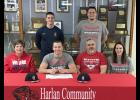 HCHS senior Ryan Doran (front row, second from left) is seated next to his parents as well as sister Katelynn Doran (far right). Back row, L-R: Southwestern Community College baseball coach Kenny Namanny and Ryan's older brother, Randy.
