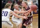Exira-EHK guard Ellie Schultes is pressured by a pair of Boyer Valley girls, including Grace Reineke (20).