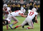 HCHS senior Allen Fries (17) records a sack vs. Atlantic with help from Will McLaughlin (82). Both were named first-team All-District.