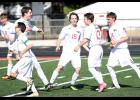 HCHS players celebrate the team's first goal of the match by Levi Culp during Tuesday's 3-2 win over Council Bluffs Thomas Jefferson. Left-right: Jordan Fink, Dylan Eshelman, Drew Voge, Alex Wingert (15), Levi Culp (13) and Michael Heithoff (16).