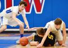 Viking players Raydden Grobe (left) and Clayton Akers scramble for a loose ball with T-C's Leyton Nelson.