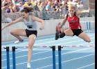 STATE MEDALIST -- HCHS junior Chloe Hansen (right) clears the final hurdle in the 3A 400-meter hurdles race. Hansen placed eighth with a personal-best time of 1:06.41.