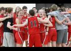 The HCHS Red Team huddles together before the second half of Thursday's Unified Basketball Scrimmage in Harlan. Mike Kenkel (11) joins the group as Jocelyn Cheek (left) and Brecken Van Baale call out to the rest of the squad.