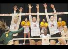 Iowa State freshman and 2015 Harlan Community graduate Jess Schaben (14) forms a blockade at the net with teammates Tory Knuth (12) and Ciara Capezio (11) during the Cyclones' November 24 home match against Baylor.