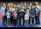 Harlan's Jim Bruck (center) received his IHSAA Wrestling Officials Hall of Fame plaque prior to the state meet finals Feb. 22. He was joined on the Wells Fargo Arena floor by his family. Jim and his late wife Julie have four children - Michelle (Jason) Kruse, Tara (Steve) Bubb, Ryan Bruck and Ashley (Jeff) Petersen - and 12 grandchildren. (Photo courtesy of Matt Gengler, Missouri Valley Times)