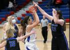AHSTW senior Kailey Jones (center) is surrounded near the high post area by CAM's Mallory Behnken (53), Meredith Rich (14) and another Cougar player during Tuesday's game. (Photos by Mike Oeffner)
