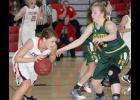 HCHS senior Maggie Langenfeld looks to drive around Sydney Fields of St. Albert during Tuesday's home game.
