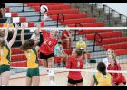 HCHS senior Macie Leinen (6) hits over the block of St. Albert's Lauren Williams (7) and Elizabeth Elkins (5) during Saturday's Cyclone Tournament. Looking on for HCHS are setter Jocelyn Cheek (8), Delaney Wegner and Ashley Hall. The Cyclones beat St. Albert in two sets to finish 2-1 on the day.