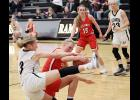 Cyclone junior Macie Leinen (center) battles Glenwood freshman Jenna Hopp for a loose ball during the second half of Saturday's Class 4A regional game. Also pictured are Ashley Hall of HCHS (15) and Glenwood's Elle Scarborough. (Photos by Mike Oeffner)