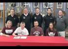 Hunter Manz (front row, second from left) is seated next to his parents, Chad and Alison Manz of Harlan, and younger sister Haley Manz. Back row, left-right: HCHS boys head basketball coach Mitch Osborn, Morningside head coach Jim Sykes, Morningside assistant coach Trent Miller, HCHS assistant coach Kevin Osborn and HCHS assistant coach Chad Swanson. (Photo contributed)