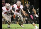 Cyclone brothers Jake McLaughlin (83, senior) and Will McLaughlin (82, freshman) chase after Winterset quarterback Casey Kleemeier during Friday's second half. Jake got there first to record the sack as HCHS prevailed 28-0. (Photos by Mike Oeffner)