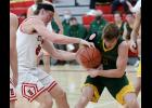 HCHS junior Will McLaughlin (left) tries to take the ball away from Sam Rallis of St. Albert during Friday's Hawkeye Ten Conference game. (Photos by Mike Oeffner)