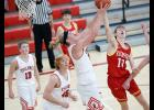 HCHS junior post Will McLaughlin pulls a rebound away from Kuemper's Mitchell Badding (10) during Tuesday's 59-45 Cyclone victory. (Photos by Mike Oeffner)