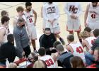 HCHS head coach Mitch Osborn (center) talks to the team during a timeout on Friday night. (Photos by Mike Oeffner)