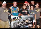 Standing next to his wife Anita and her daughter, Maggie Dargy, Harlan driver Mike Nichols (second from left) holds the congratulatory banner he received from the U.S. 30 Speedway in Columbus, Neb., after earning his 400th career race win in the IMCA Stock Car Division June 23. Members of Nichols' pit crew include Josh Nielsen (far left), Stan Nichols (Mike's father), Justin Gessert and Mike Dierks. (Photo courtesy of Dave Schraeder, Schraeder Photography)