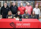 Jon Owens (front row, second from left) is seated next to his parents, Rod and Julie Owens, and his younger sister Allison (far right). Back row, left-right: HCHS head football coach Curt Bladt and assistant coaches Mark Kohorst, Sam Brummer, Todd Bladt and John Murtaugh.
