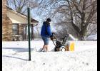 Tim Pederson clears his sidewalk on Sunday.