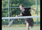 HCHS junior Alec Plagman charges the net for a return shot in Thursday's 8-2 singles win over Audubon's Aden Torneten. (Photo courtesy of Caleb Nelson, Audubon County Newspaper)