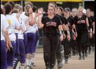 HCHS sophomore Morgan Schaben leads her teammates through the handshake line following Thursday's eight-inning 3-2 loss to Nevada in Class 4-A regional play.