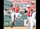 Harlan Community's Dillon Sears (1) and Brett Sears leap in celebration of the Cyclones' 6-3 state semifinal win over Bishop Heelan at Principal Park. HCHS advanced to the state championship round for the third year in a row. Also celebrating the final out are Ryan Doran and Luke Schaben.
